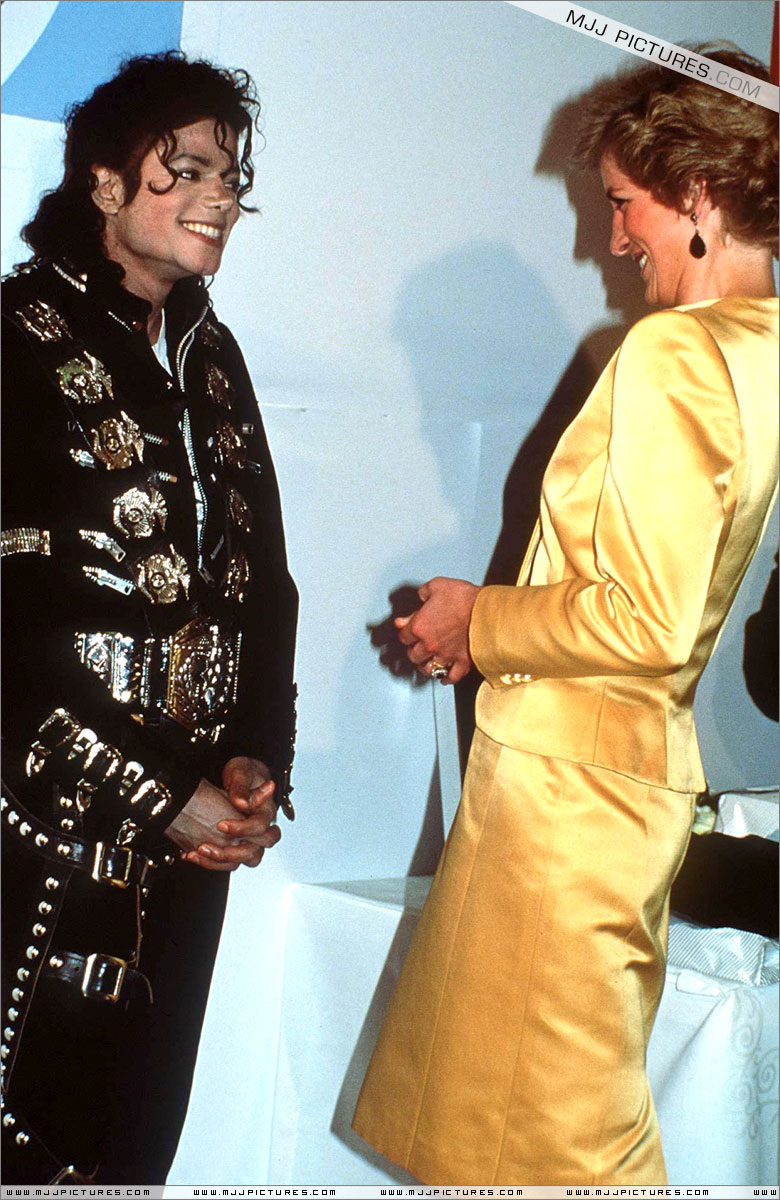 Michael meets Princess Diana & Prince Charles backstage before the concert.   007